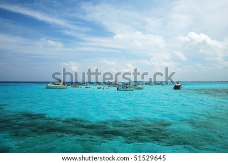 The famous tourist attraction to meet wild stingrays in the unique shallow spot so called Stingray City (Cayman Islands). - stock photo