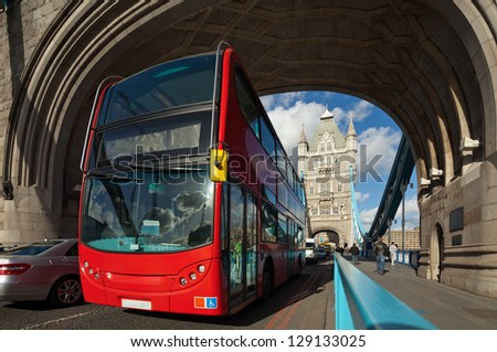 The famous Tower Bridge in London, UK. Double-decker bus passes under the arch of the tower. Sunny day. Cityscape shot with tilt-shift lens maintaining verticals - stock photo