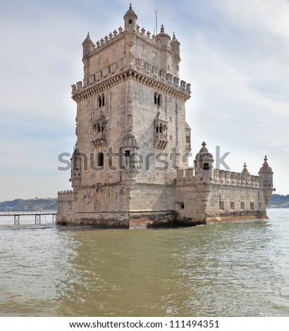 The famous Tower of Belem in the water of the river Tagus. White marble tower is decorated with turrets and battlements in the Moorish style. Portugal, Lisbon