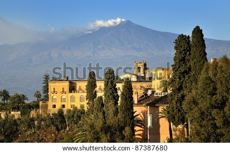 The famous view of Etna volcano from historical city Taormina, Sicily - stock photo
