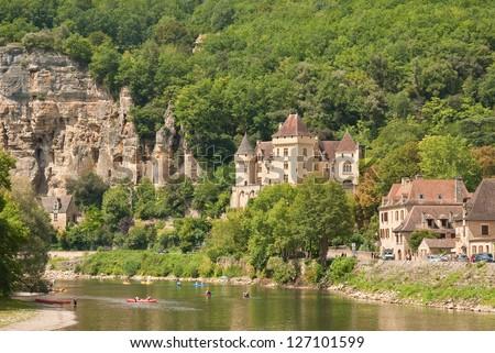 The famous village La Roque-Gageac and river Dordogne, Perigord, France - stock photo