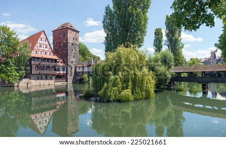 The famous Weinstadel, Wasserturm (Water Tower) and Hangman's Bridge over the river Pegnitz in the German city of Nuremberg. - stock photo