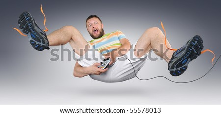 The fan gamer in shorts with gamepad - stock photo