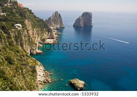 "The ""Faraglioni"" in Capri (famous seaside rock formations). View of the coastline of the island of Capri, Amalfi Coast, Italy - stock photo"