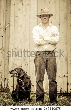 The Farmer and his Best Friend the Dog - stock photo