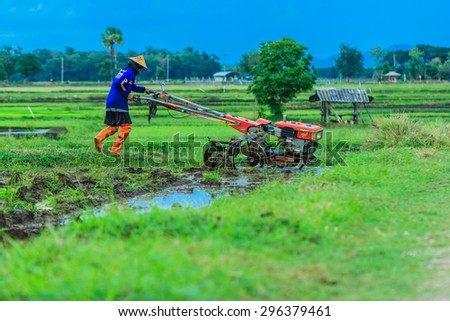 The farmer with a tractor after the rainy season to start walking-but to sow the. Thailand farmers around everywhere are starting to plow their rice-Lampang Thailand - stock photo