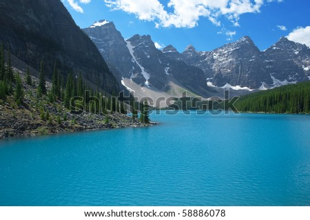The fascinating turquoise waters of Moraine Lake, Banff National Park. - stock photo