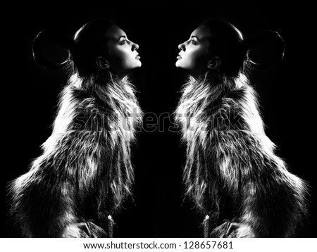 The fashionable black-and-white photo with two girls looking at each other - stock photo