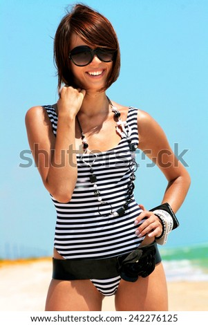 the fashionable girl against the sea - stock photo