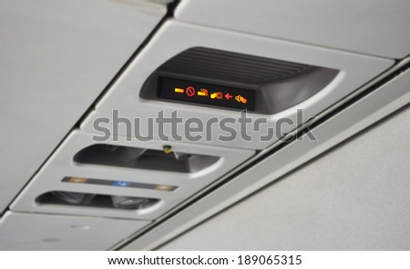 The fasten seat belt light has come on.  - stock photo
