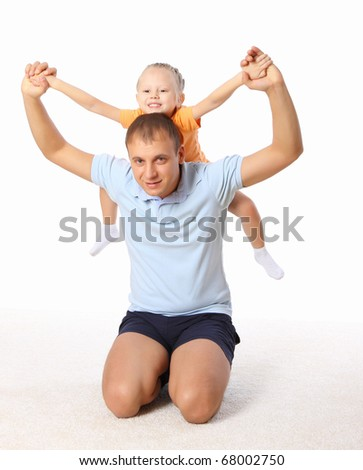 The father holds the little daughter in his arms. - stock photo