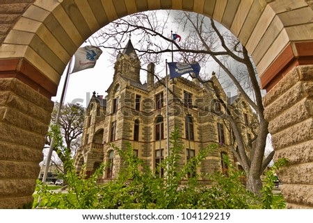 The Fayette County Courthouse in La Grange, Texas. It is located on Main Street and is registered as a National Historic Place. - stock photo