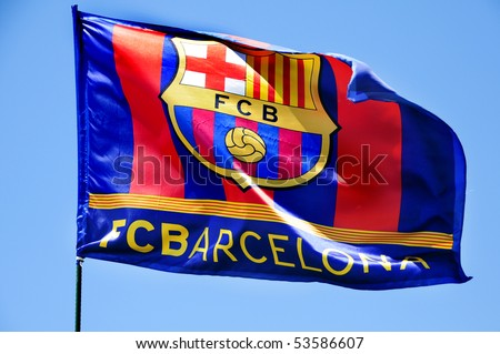 the FC Barcelona flag waving on the wind