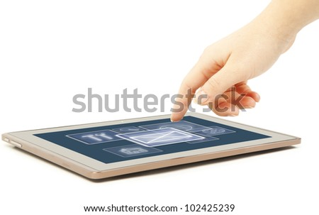 The female hand touches by a finger the tablet screen