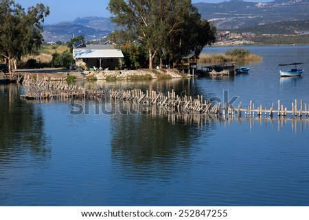 The fence in the water on a fish farm in Turkey - stock photo