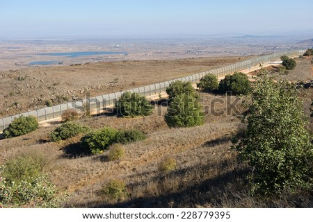 http://thumb7.shutterstock.com/display_pic_with_logo/733993/228779395/stock-photo-the-fence-of-the-border-between-israel-and-syria-as-seen-from-a-hill-on-the-golan-heights-about-228779395.jpg