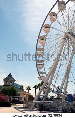 the ferris wheel at the beach ammusement park - stock photo
