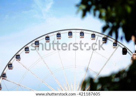 The Ferris wheel swing ride in theme park - stock photo
