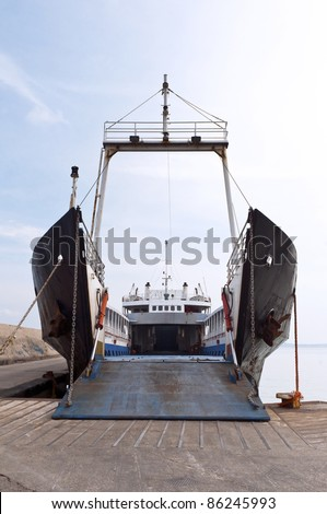The ferry at the port with an open gate - stock photo