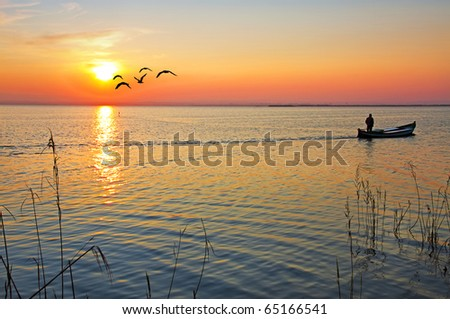 the ferryman and the sun - stock photo
