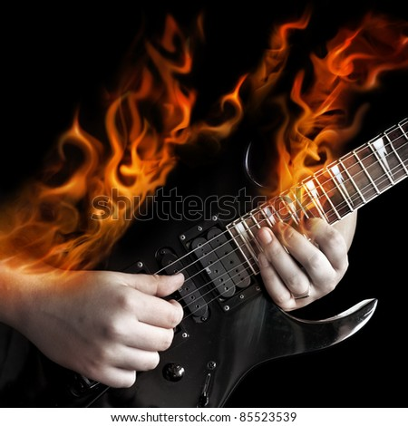 The fiery guitarist - stock photo