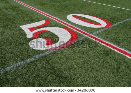 The Fifty Yard Line on New Astro Turf - stock photo