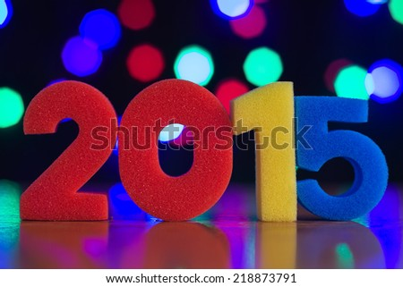 The figure in 2015 against the background of colorful bokeh. - stock photo