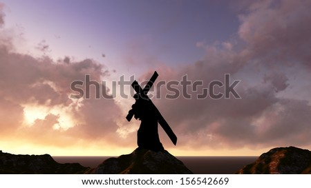 The figure of Christ carrying the cross up Calvary on Good Friday. The sky is dark and stormy. - stock photo