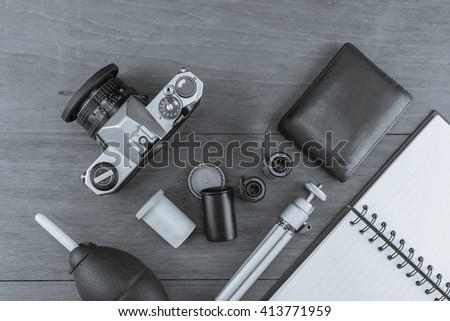 The film 35 mm. with the camera film system. Convert it to black and white./ Film camera systems - stock photo