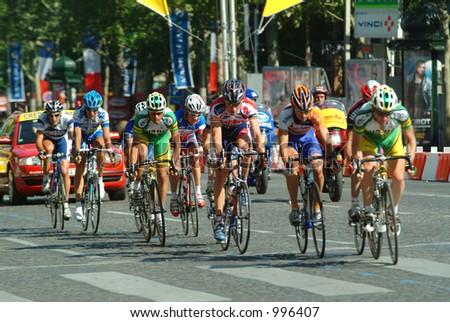 The final laps of the 2004 Tour de France in Paris - stock photo