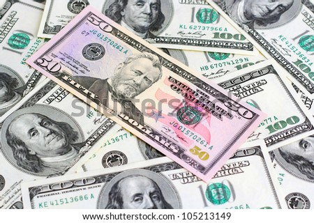 The financial concept of earnings, American dollars, background. - stock photo