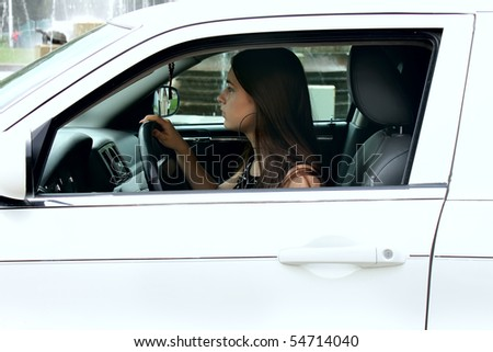The fine girl in the car - stock photo