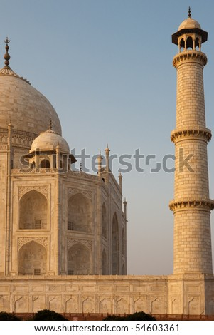 The fine marble details of an empty Taj Mahal are visible at sunset. - stock photo