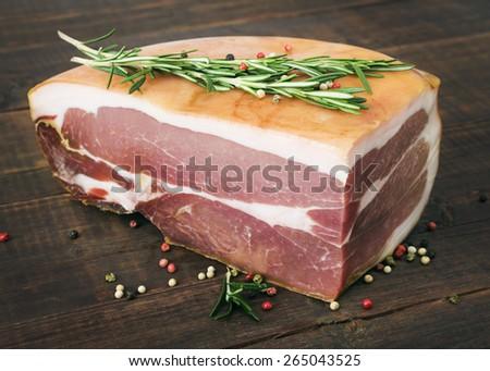 The finest prosciutto on wooden board - stock photo