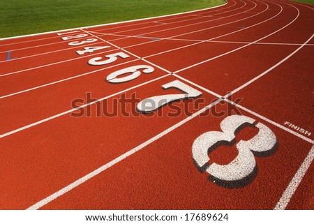 The finish line at a race track - stock photo