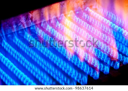 The fire burns from a gas burner inside the boiler. & Fire Burns Gas Burner Inside Boiler Stock Photo (Royalty Free ...