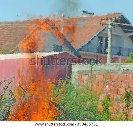 The fire in a populated area with green surfaces - stock photo