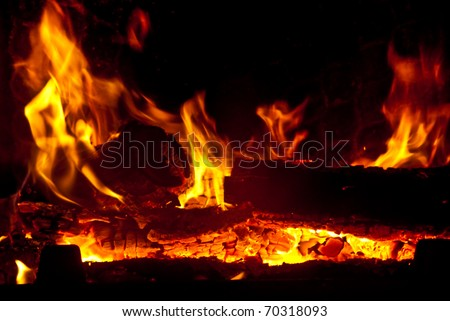 The fire in the fireplace - stock photo
