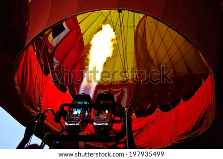 The fire inside the hot air balloon - stock photo