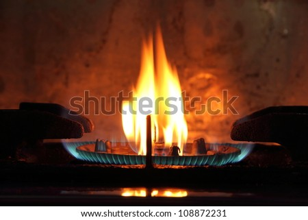 The fire of gas on the kitchen furnace. - stock photo