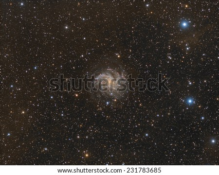 The Fireworks Galaxy, also known as NGC6946, is a spiral galaxy about 22.5 million light years away in the constellation Cepheus. - stock photo