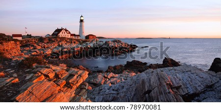 The First Light Of Dawn At The Portland Head Light, A Classic New England Lighthouse, Portland Maine, USA - stock photo