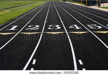 The first 5 lines of an athletic track. - stock photo