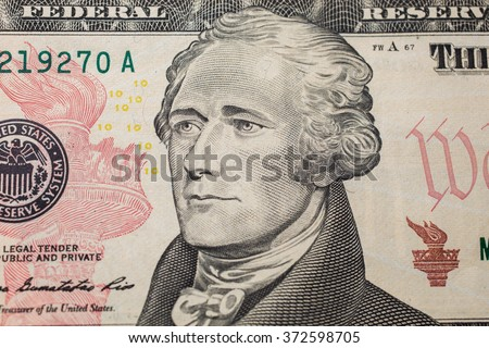 the first Treasury Secretary Alexander Hamilton on ten dollar bill, money background ,ten dollar bills front side obverse. background of dollars, close up, America - stock photo