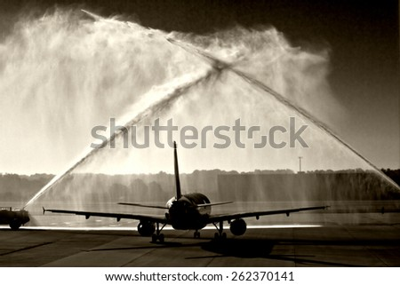 The first Triad Flight of Honor taking World War II veterans to visit their Memorial in Washington DC, as it leaves Greensboro, NC under a water cannon salute.  - stock photo