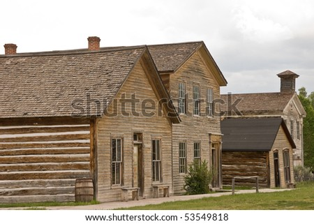 The first two-story building was a rooming house and the second one was a combination school and Masonic Lodge in Bannack, Montana.  Now they are part of the Bannack State Park ghost town. - stock photo