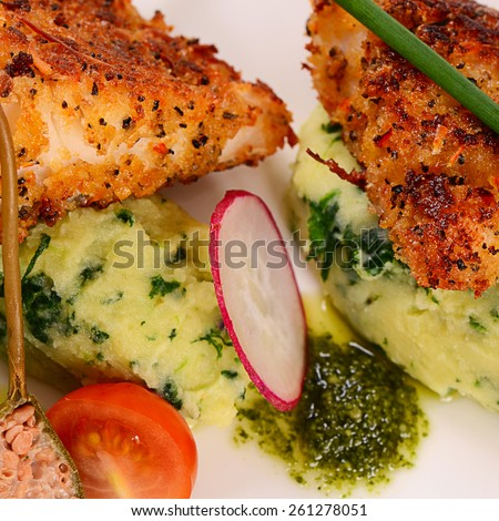 The fish in breadcrumbs with mashed potatoes