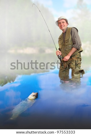 The fisherman catching a fish. - stock photo