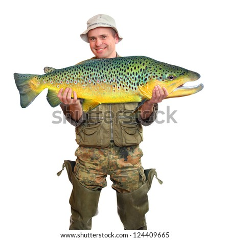 The fisherman with big fish (Brown Trout - Salmo Trutta). Success concept. - stock photo