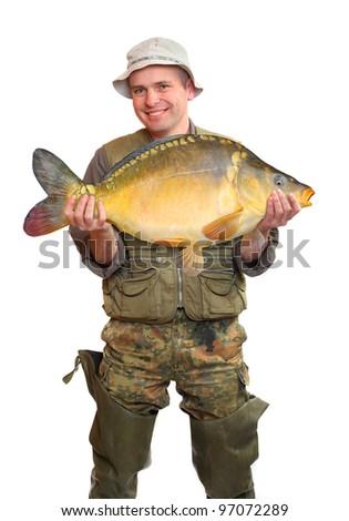 The fisherman with big fish (Common Carp - Cyprinus Carpio). Success concept. - stock photo